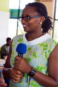 Mugethi presenting at a community event